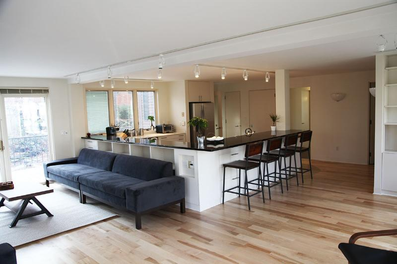 Welcoming open floor-plan features social, renovated kitchen and modern furnishings.