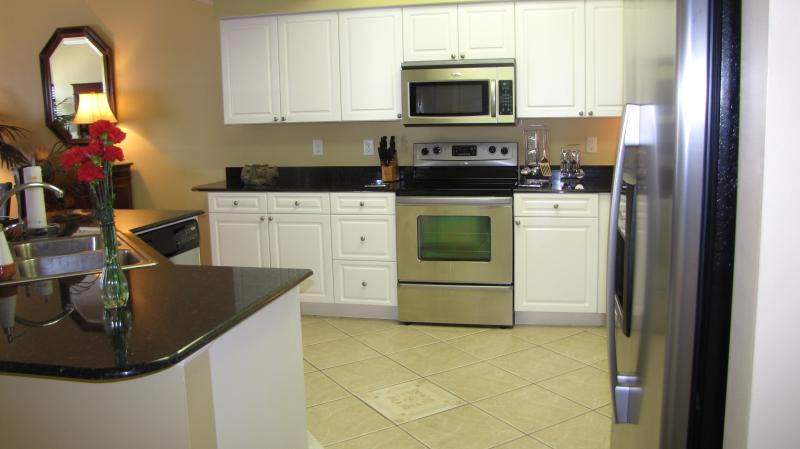 Huge kitchen, granite counters and stainless steel appliances