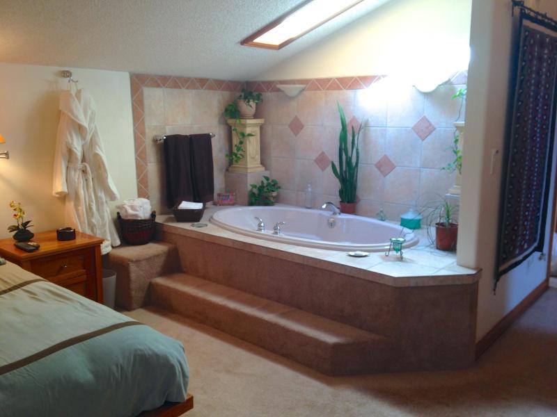 En suite soaking bathtub
