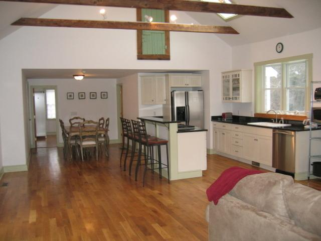 Open kitchen and family room. Dining area sits 6, with more chairs available.