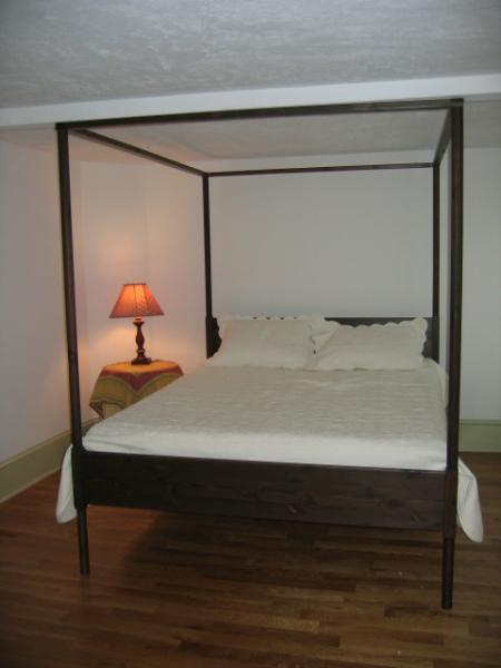 Queen bed on second floor, large room with space for a portable crib if needed. AC unit