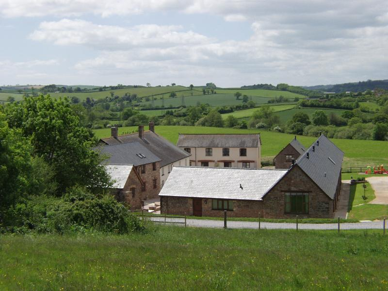 Birds Eye view of Newhouse Barton set in the rolling hills of South Devon