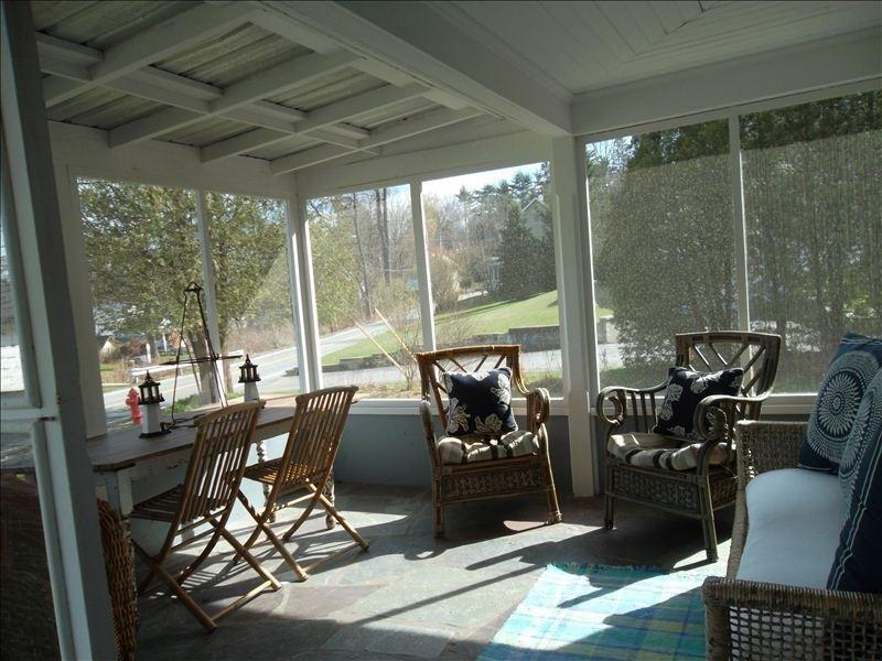 Relax and enjoy a cup of coffee on the screened in front porch
