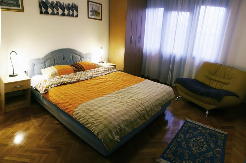 Comfortable bedroom with double bed