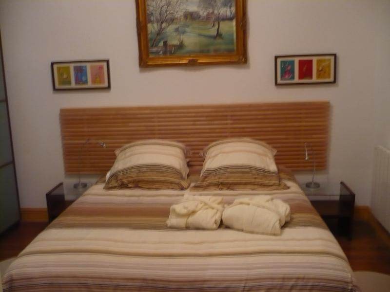 bedroom 1 with double bed and fitted wardrobes