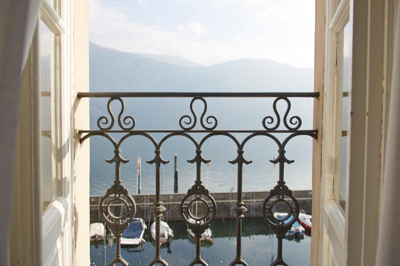 The view of Cannobio's old harbor and Lago Maggiore from the apartment's living room.