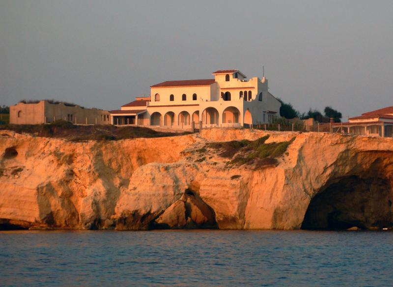The house on the cliff at sunset