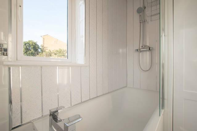 Bathroom, clean bright new bathroom with bath and rain head shower