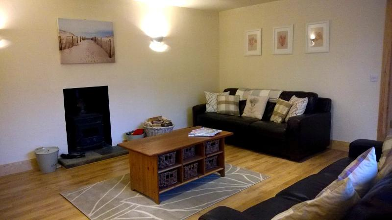 Unwind in the sitting room with wood burning stove