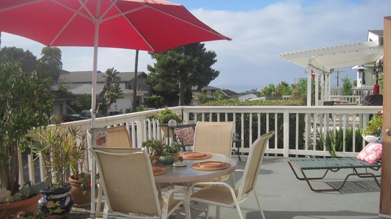 Extra large deck with gas grill plenty of seating, ocean view