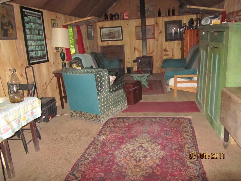 Inside of the lower bush cabin. It has a double futon and couch for sleeping. Can sleep three.