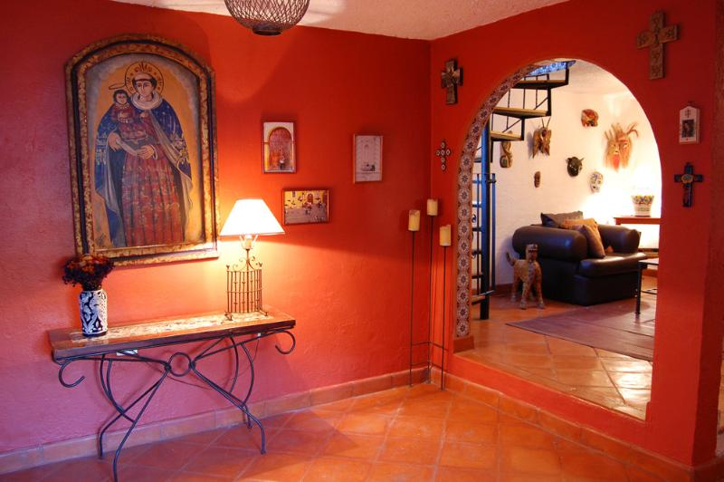 Foyer and living room with Mexican folk art and tiled arches