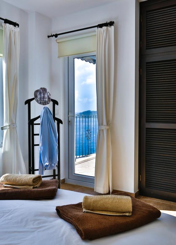 Master double bedroom with private balcony.