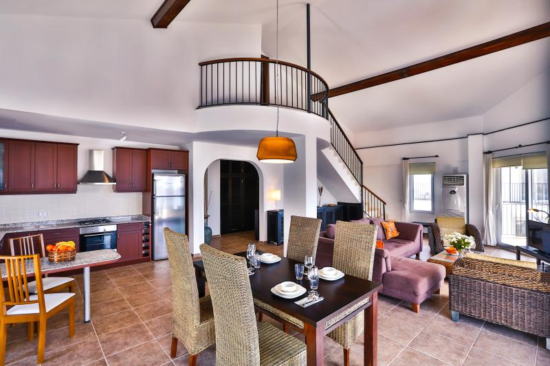 Open plan lounge, dining and kitchen area.