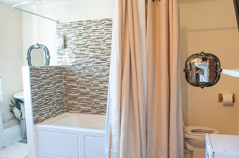 Open concept jacuzzi/shower in the room.