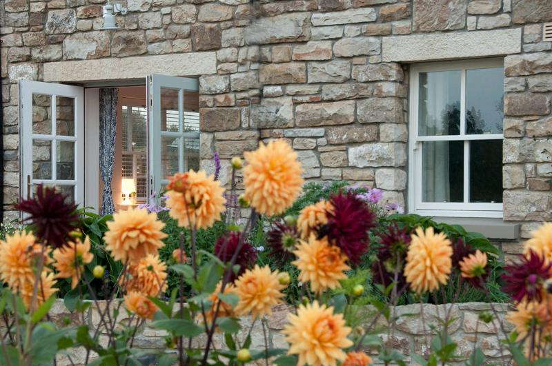 French doors to the patio and herb garden