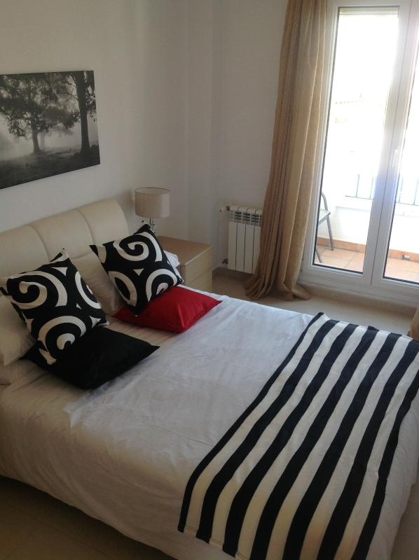 Bedrooms have balcony overlooking pools