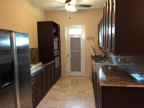 Full Kitchen View includes side by side refrigerator