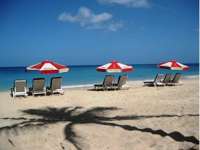 Your beach chair awaits on nearby Mullins Beach - drinks served on the sand.