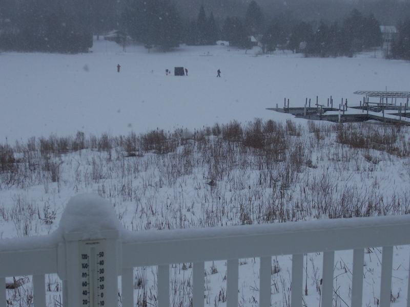 Winter 2014 ice fishing right outside the back of the condo. Just watch or 'go fish.'