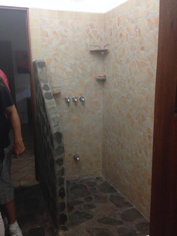 Slate stone and ceramic, open showers with unlimited 'hot' water allow for hot tropical showers !