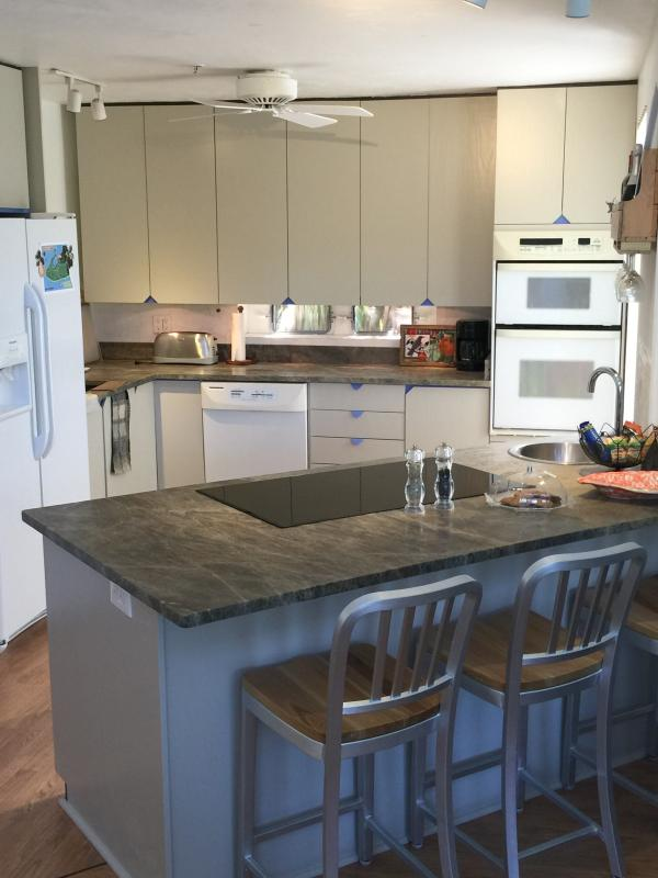 Fully stocked kitchen with granite counter tops and 2 sinks.