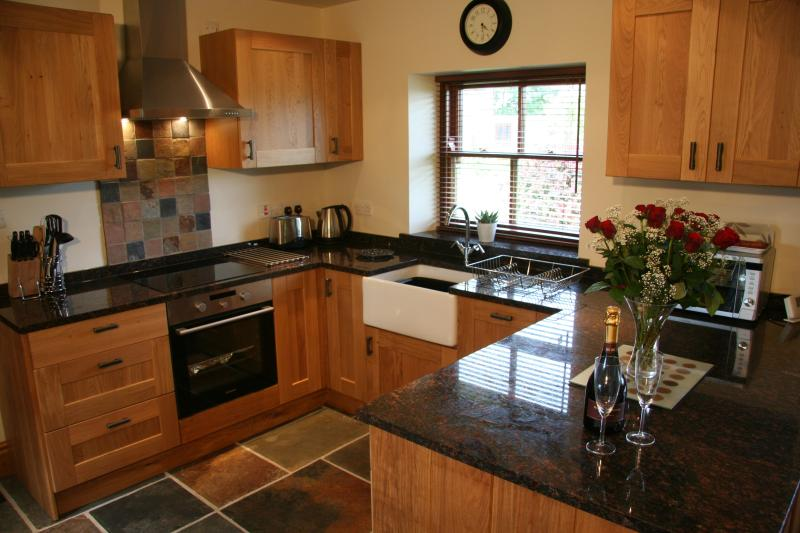 Beautiful open plan kitchen with all mod cons including dishwaasher and granite worktop.
