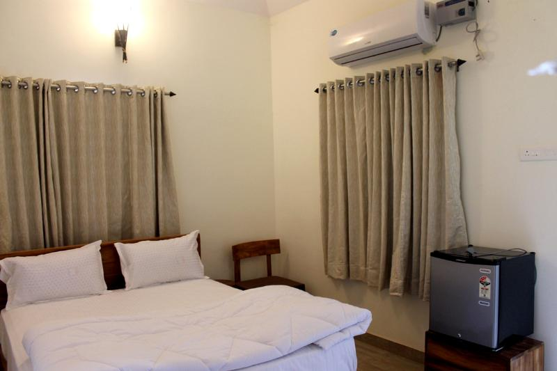 Rooms view: Queen bed, bed side tables, fridge, AC, privacy curtains