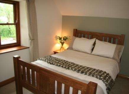 Our lovely double room with chunky oak bed.