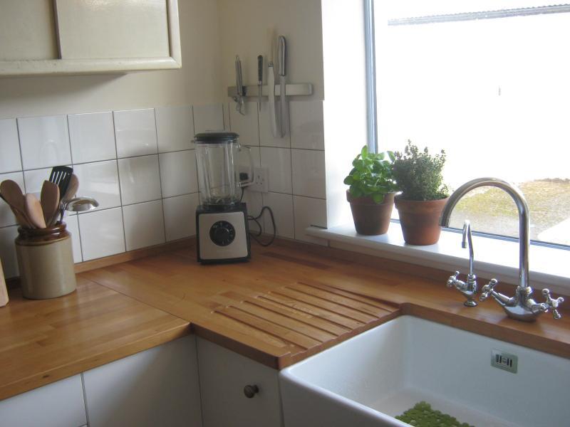 Kitchen with new wooden worktop and belfast sink
