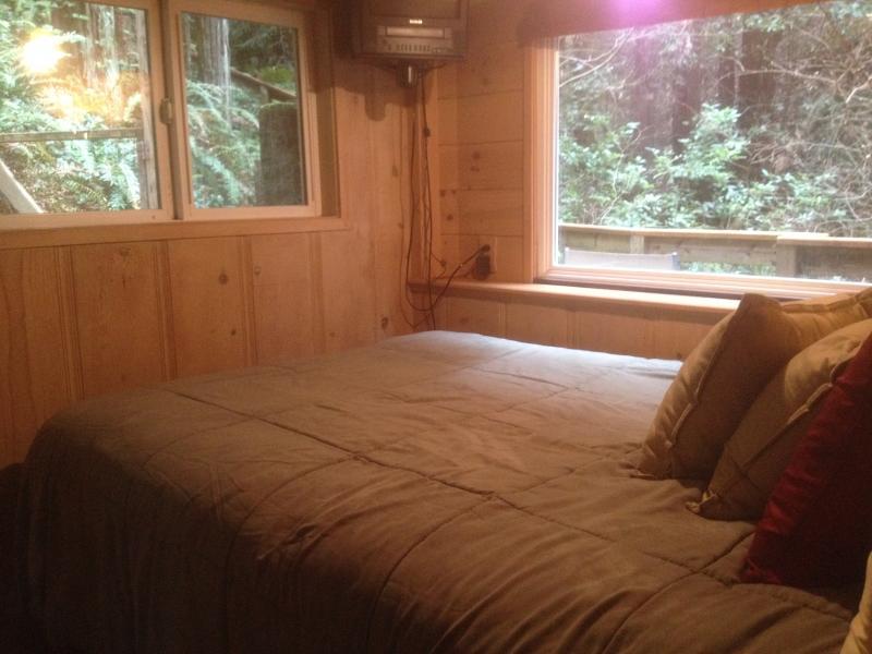 Cozy queen bed with sweet corner window views...