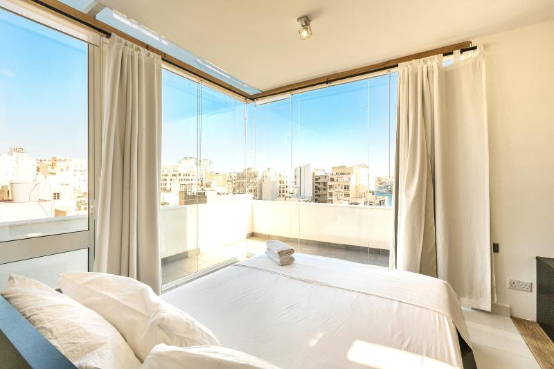 Blue Room (penthouse studio apartment) at Two Pillows