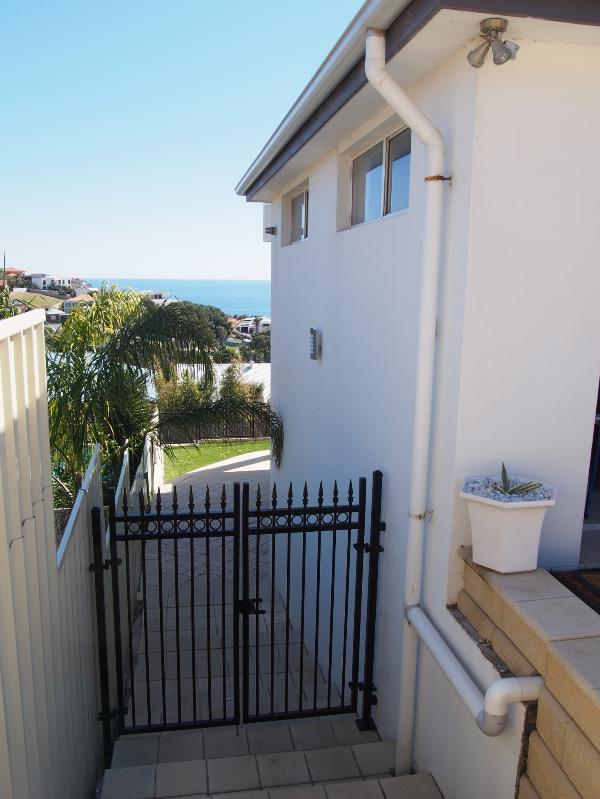 Separate apartment access through the gate on the side of the house