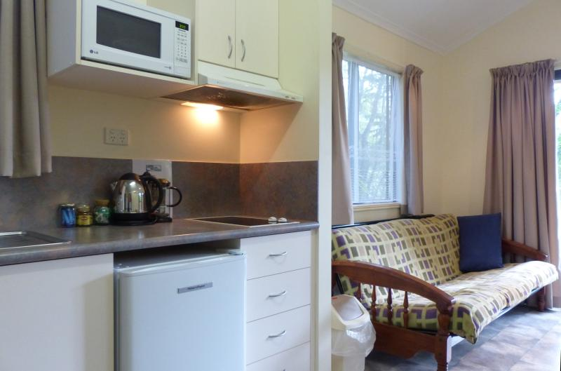 Kitchenette and Living area in self-contained  bungalow at  Daintree Valley Haven