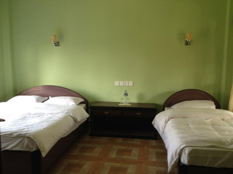 Suite deluxe room with one king size and one single beds with Air-conditions.