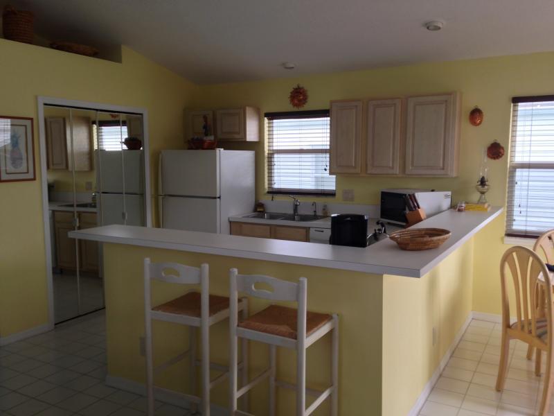 Kitchen, fridge, stove, dishwasher, microwave, kitchen stools
