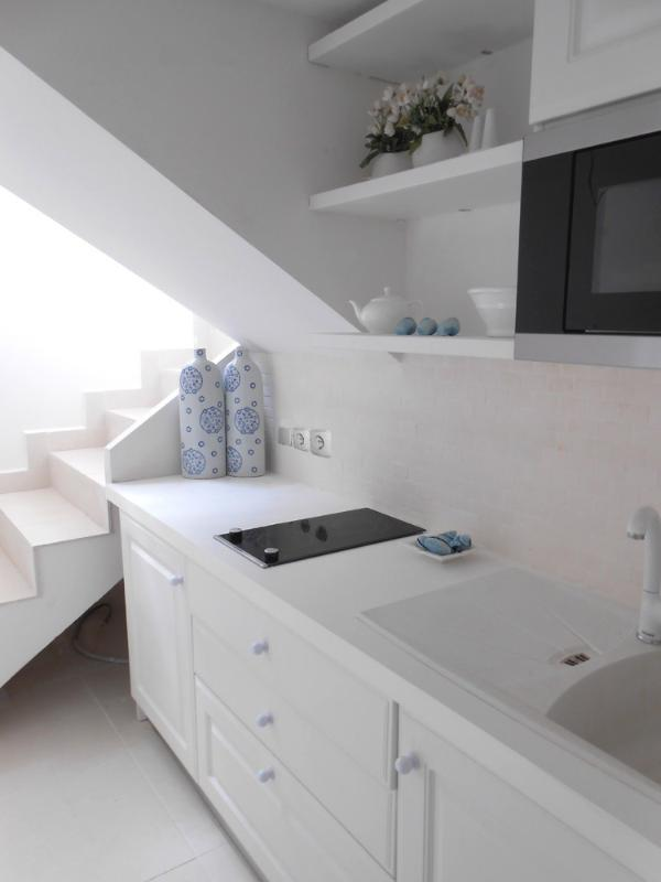 kitchen area with German units, Meile fridge, microwave and hob