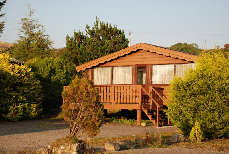 Our spacious cabin with decking and ample off road parking. Open countryside to the rear.