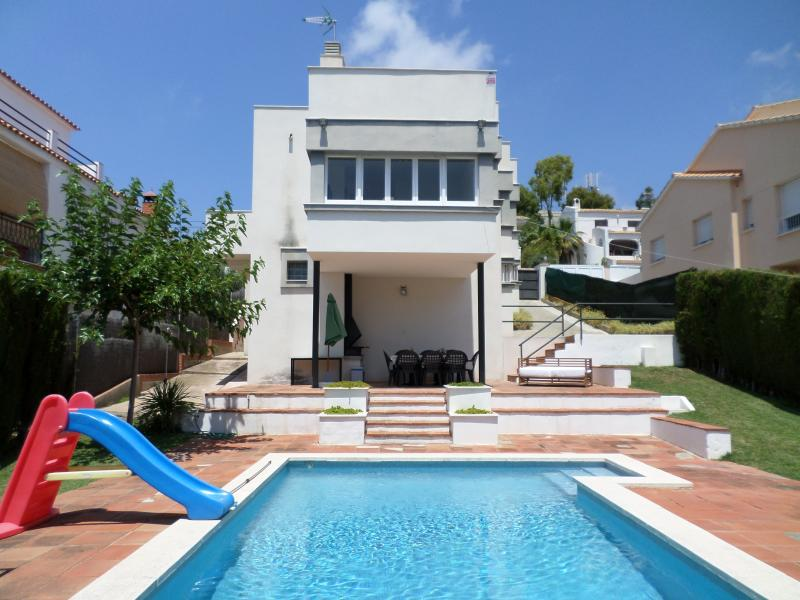 swimming pool and the front of the house