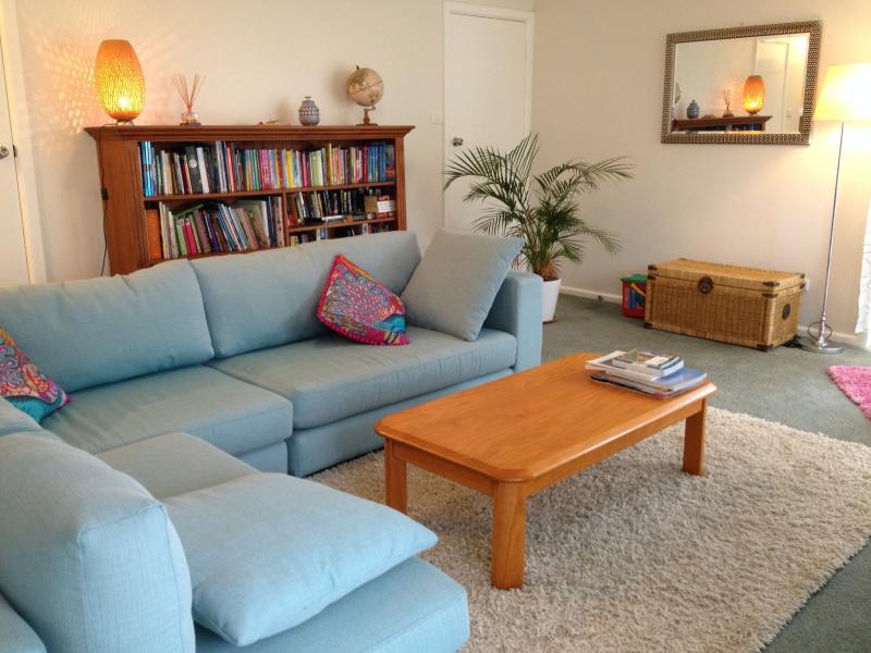 Spacious lounge with sliding doors to garden terrace