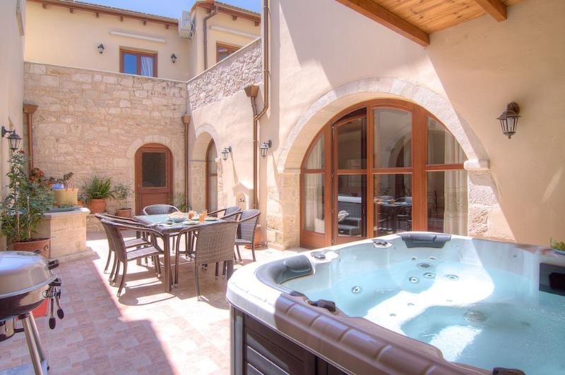 A wonderful outdoor jacuzzi tub awaits you at the terrace!