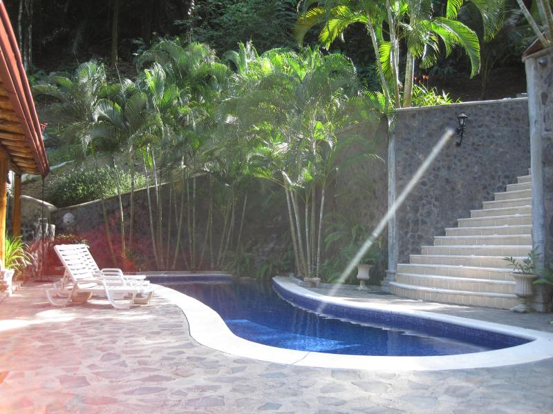 Relaxing poolside while the sounds of the rainforest envelope your spiritual senses.