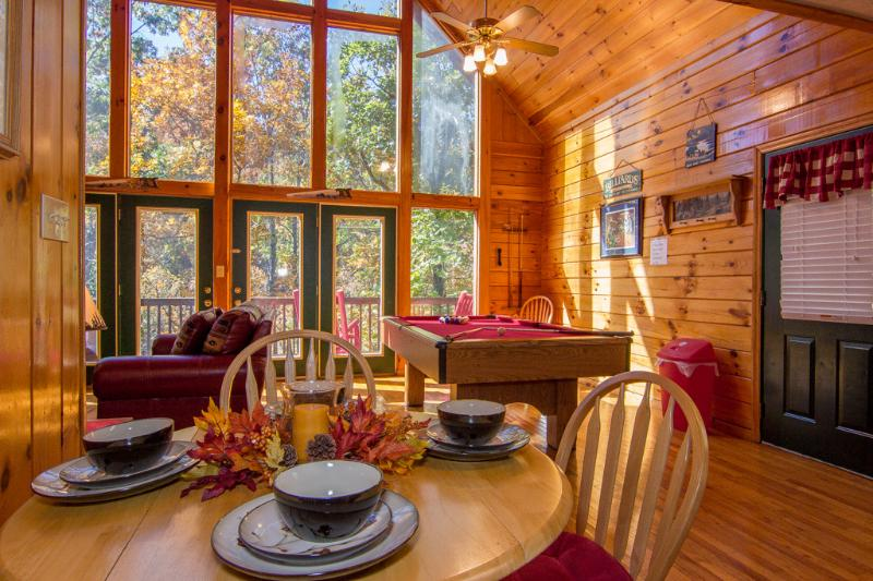 Dining Room.Full Wall Of Glass,Awesome View Fall Leaves ,