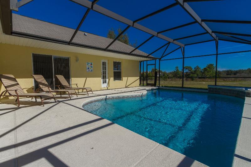 Relax and enjoy the view beside the south east facing private heated pool.