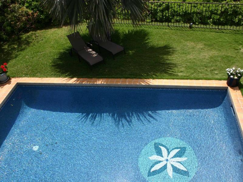Sparkling, tiled, salt water swimming pool! View from balcony