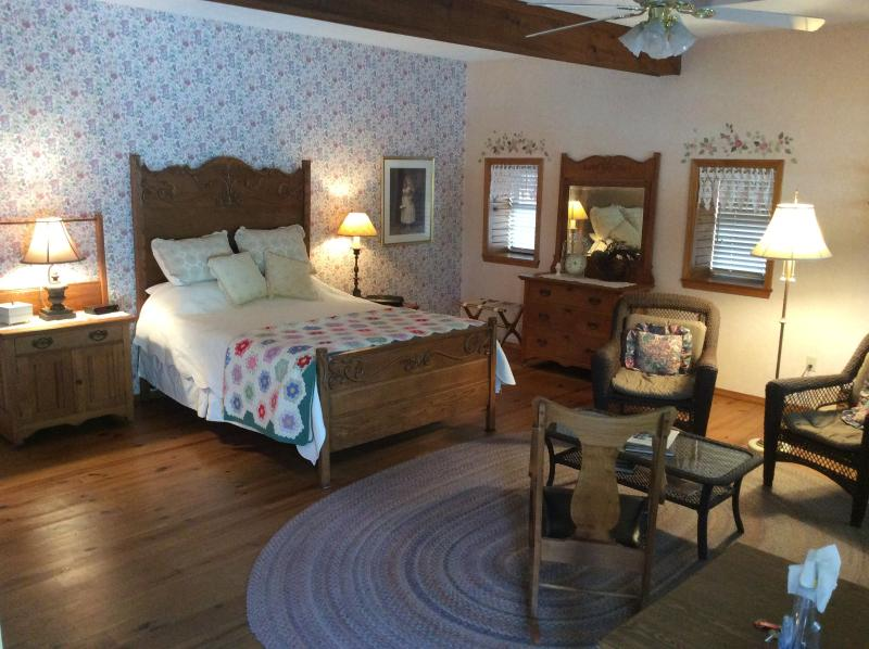One of the two spacious bedrooms features a queen bed and whirlpool bath.