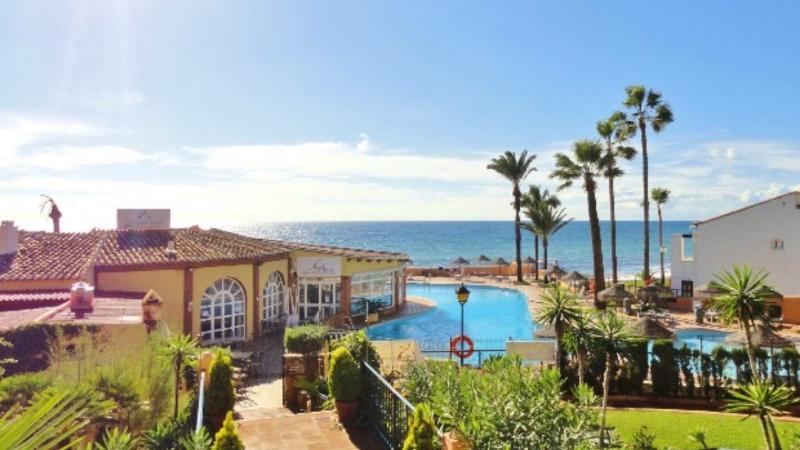 Landscaped gardens and kids pool. Restaurant and sea. 100 meters from apartment.
