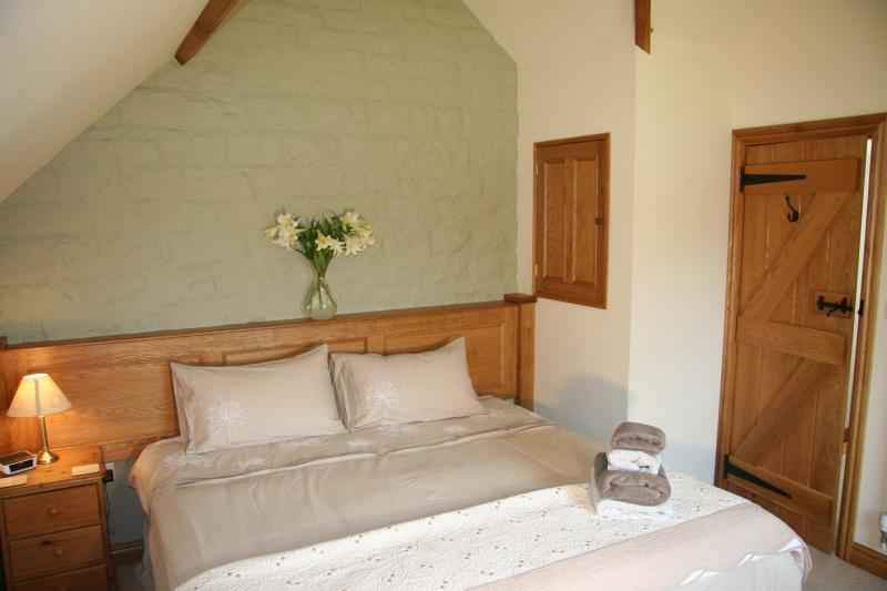Our lovely handmade oak panelling and super king bed which can be split into a twin on request.