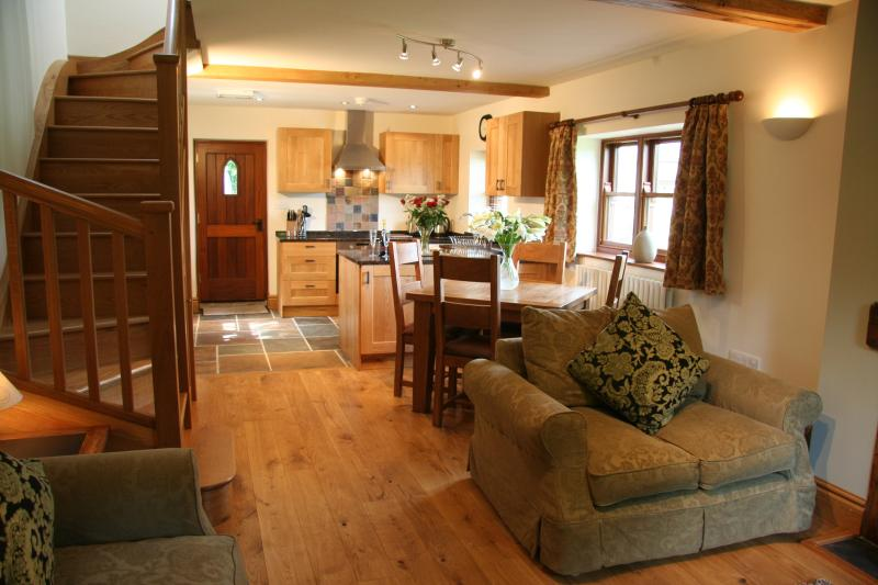 Beautiful open plan living and dining area with oak floor, handmade oak straircase and comfy sofas.