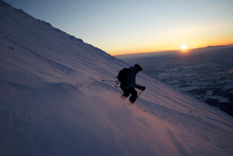 Skiing down Yotei-san at sunset